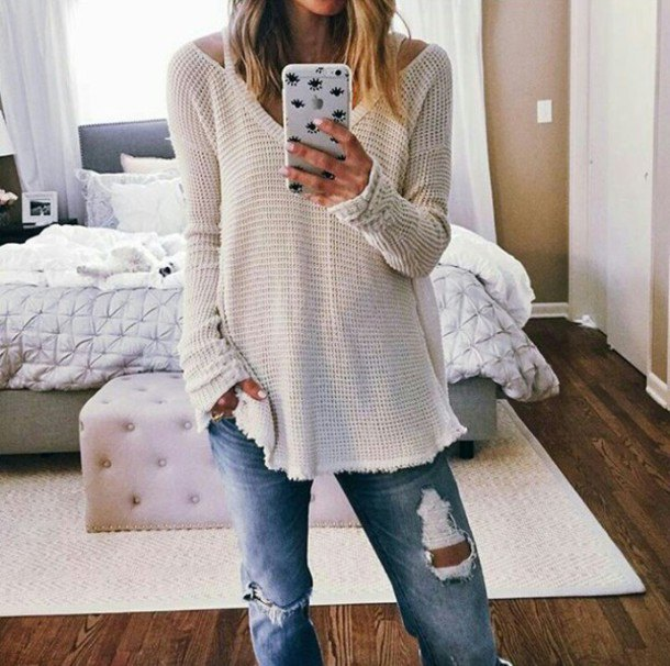 white V-neck sweater and boyfriend jeans