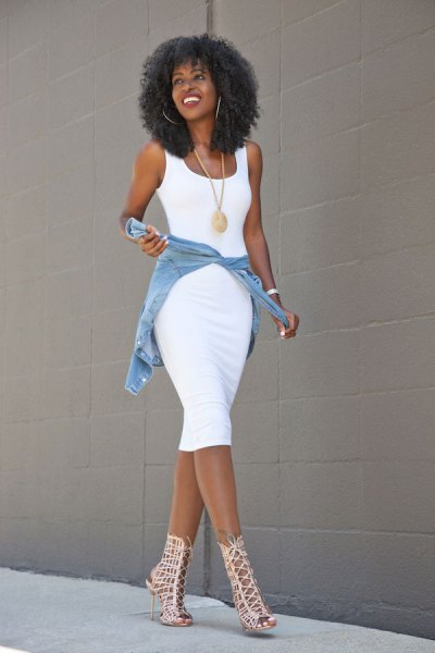 white, figure-hugging midi dress with blue denim jacket and cut-out boots with ankle heels