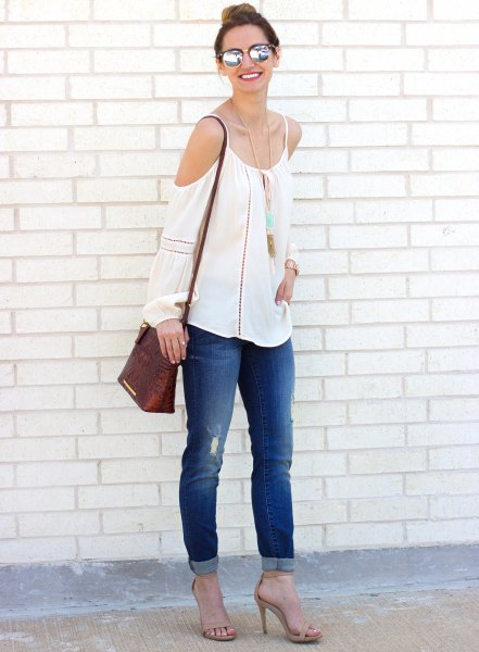 cold shoulder blouse in boho style with blue jeans with cuffs