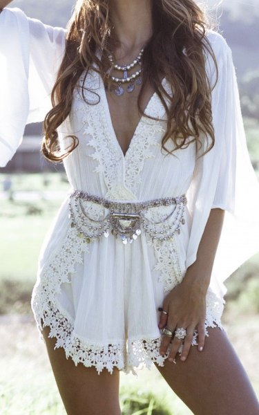 white lace wrap mini dress in boho style with silver statement belt