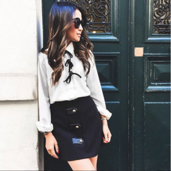 white bow tie blouse with black high rise mini skirt
