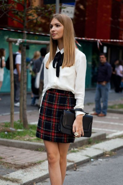 white bow tie blouse with red and black plaid mini skirt