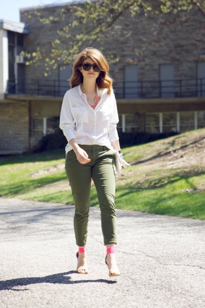 white blouse with buttons and army green ankle pants