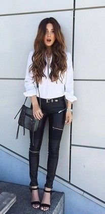 white blouse with button fastening, black biker pants and open toe heels with ankle straps