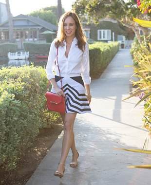 white blouse with buttons and black striped, flared mini skirt