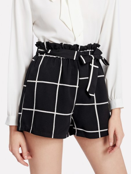 white blouse with buttons and black checked shorts