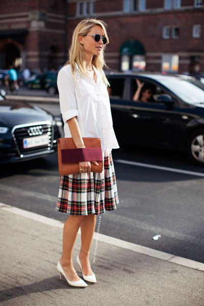 white blouse with button placket and checked skirt with a relaxed fit