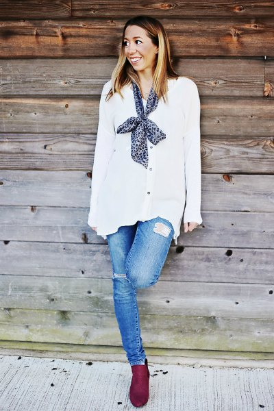white chiffon cardigan with buttons and a narrow silk scarf on the back
