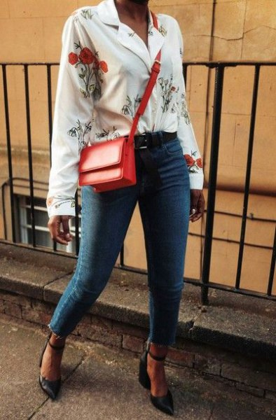 white blouse with floral pattern and blue jeans