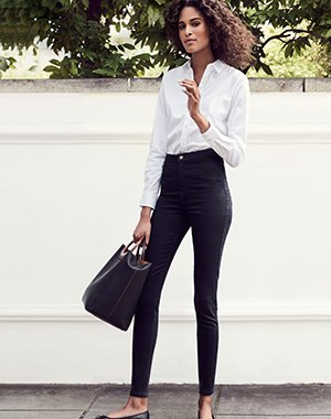 formal shirt with white buttons and black high-rise skinny jeans