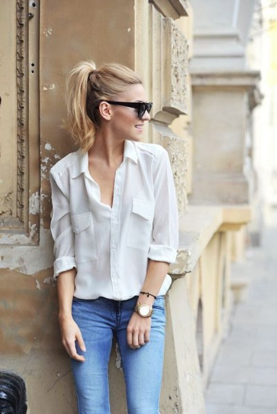 white shirt with button in front and light blue jeans