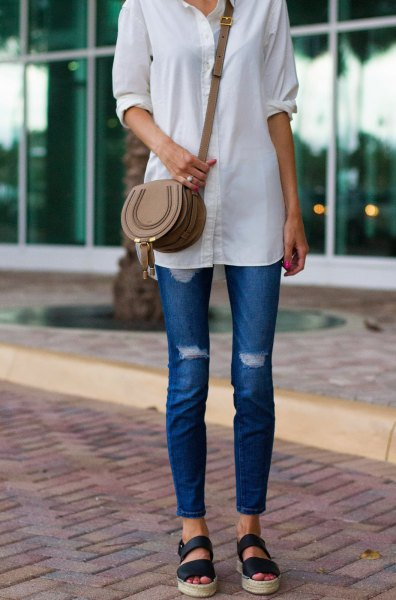 white long shirt with buttons, blue skinny jeans and sandals