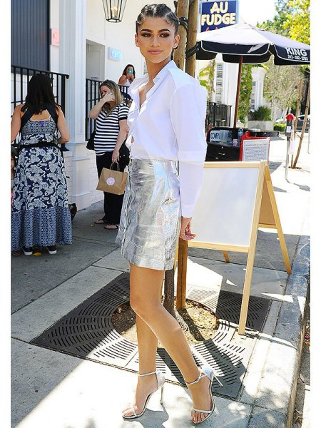 white shirt with buttons silver silver mini skirt with button placket in front