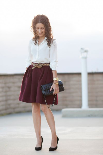 white shirt with button and minirater skirt with belt