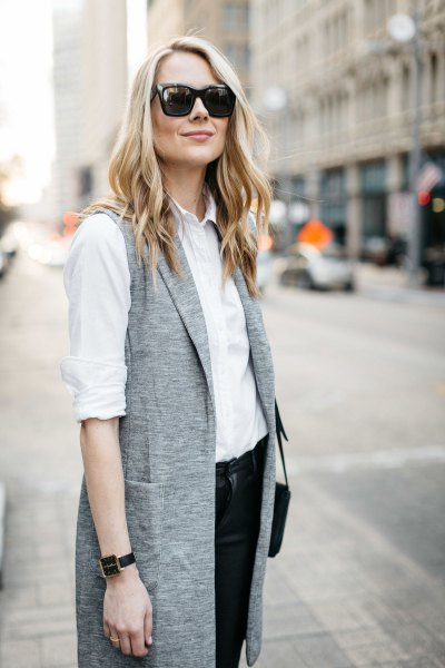 white shirt with button and black chinos and gray longline vest
