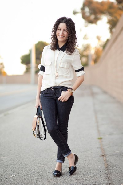 white shirt with buttons, black collar and skinny jeans with dark cuffs