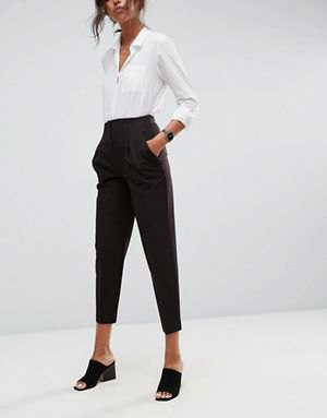 white shirt with buttons and black, short-cut chinos