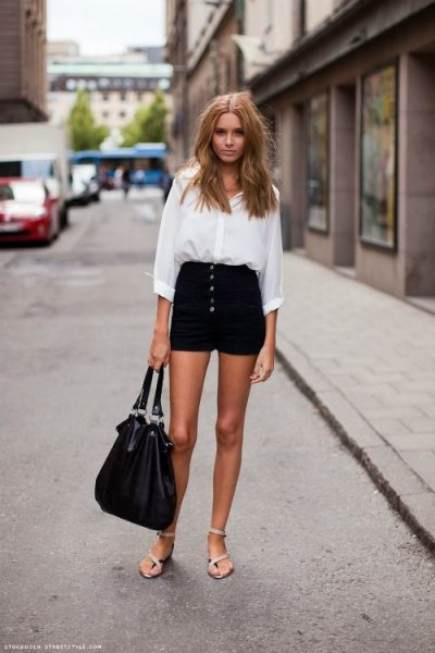 white shirt with buttons and black mini-shorts