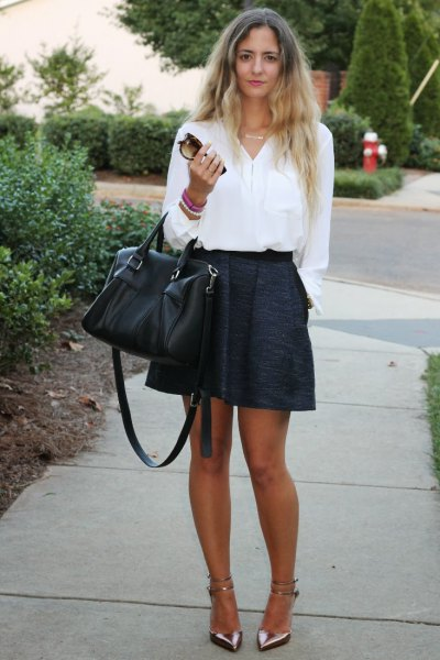 white shirt with buttons and black mini skirt