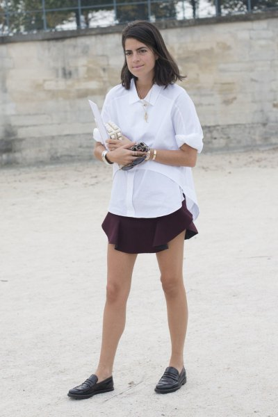 white shirt with buttons and black mini pleated skirt