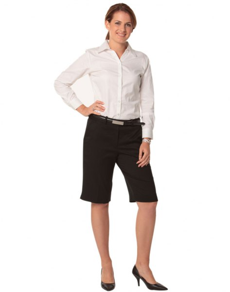 white shirt with buttons, black shorts and high heels