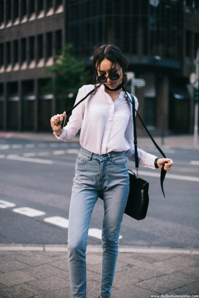 white shirt with buttons, black, narrow scarf and light blue jeans