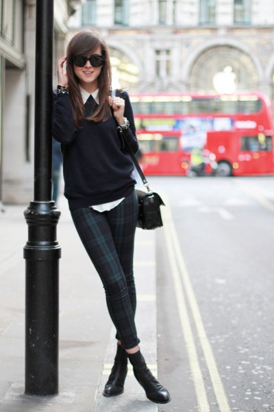 white shirt with buttons, black sweater and dark blue and gray checked drainpipe trousers