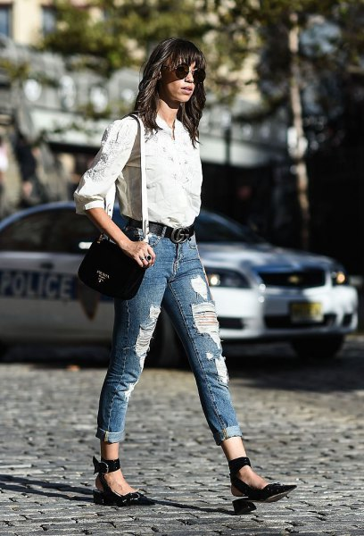 white shirt with buttons and blue jeans with cuffs