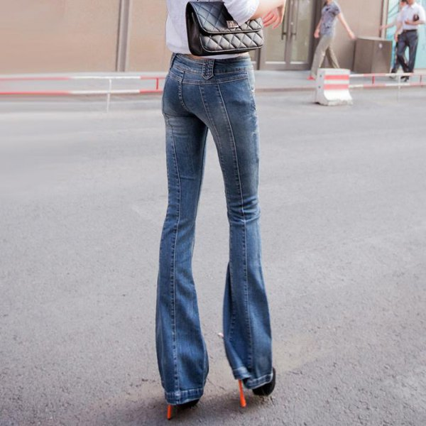 white shirt with buttons, jeans with blue flap and boots with heels