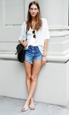 white shirt with buttons and blue mini denim shorts