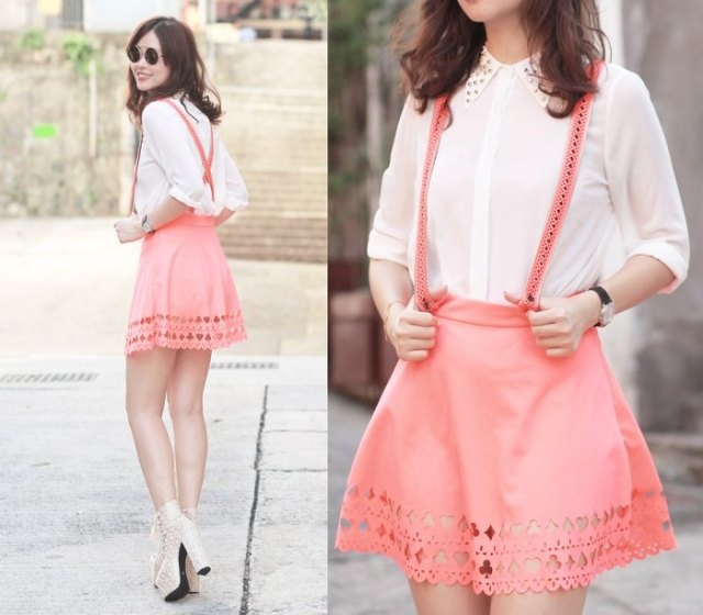 white shirt with buttons and blushing pink suspender mini skirt