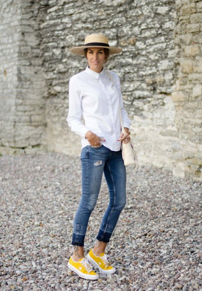 white shirt with buttons, jeans with cuffs and yellow sneakers