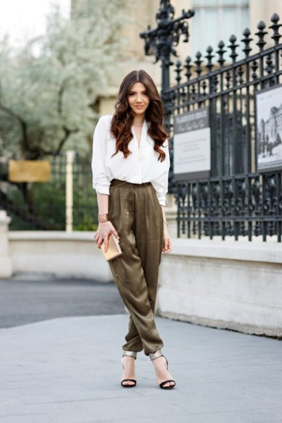 white shirt with buttons and green khaki suit trousers with elastic waist