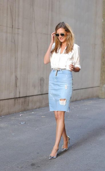 white shirt with buttons and a light blue ripped knee-length denim skirt