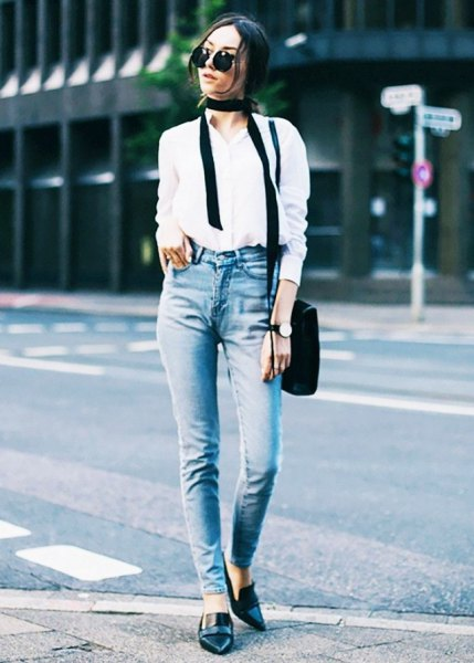 white shirt with buttons, slim fit jeans and black leather slippers with pointy toes