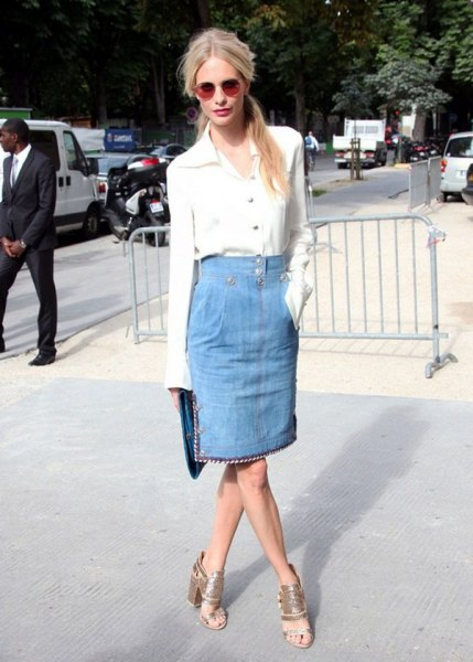white shirt with buttons and light blue knee-length skirt