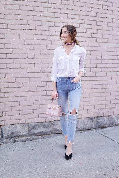 white shirt with buttons and light blue, ripped knee jeans