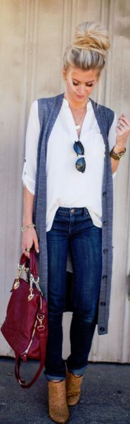 white shirt with buttons, sleeveless longline cardigan and brown boots