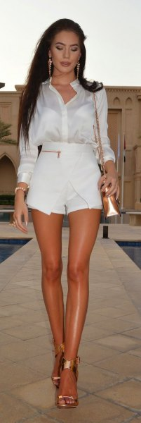 white shirt with buttons, mini skort and rose gold shoulder bag