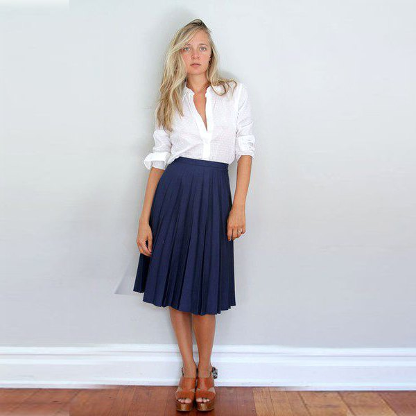 white shirt with buttons and dark blue midi pleated skirt