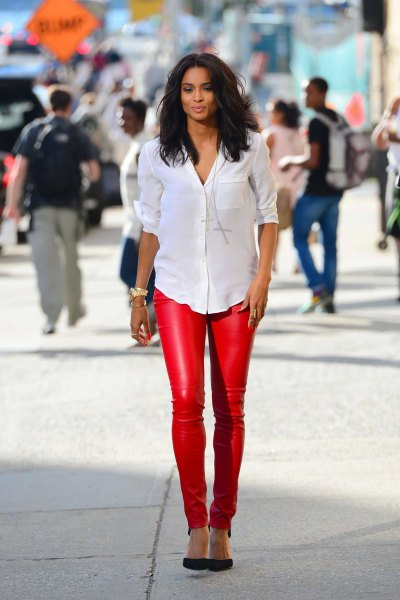 white shirt with buttons and red, narrow leather pants