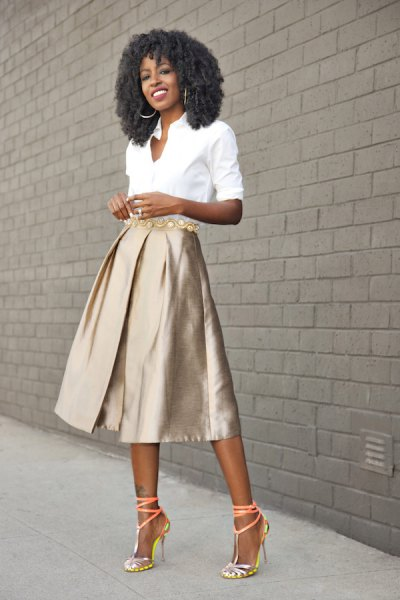 white shirt with buttons and rose gold colored midi skirt