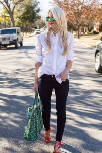 white silk shirt with buttons and black slim fit jeans