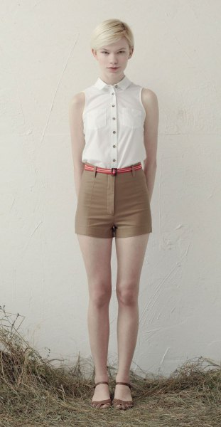 white sleeveless blouse with buttons and green mini-shorts with high waist