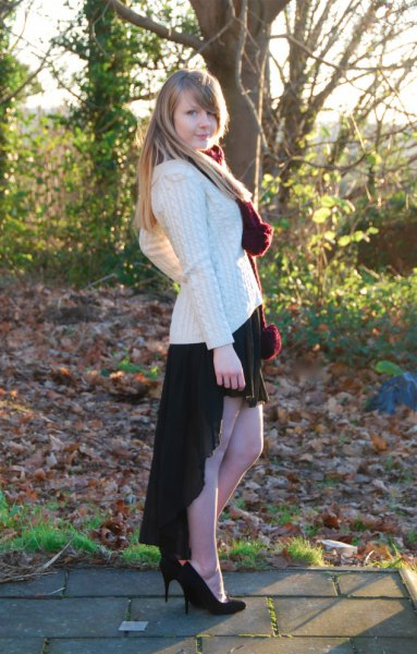 white, coarsely knitted sweater made of black cables