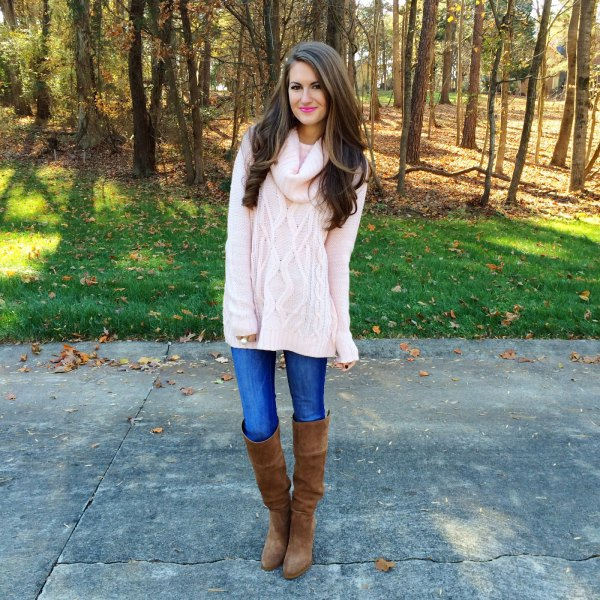white, coarsely knitted sweater with blue jeans and overknee boots