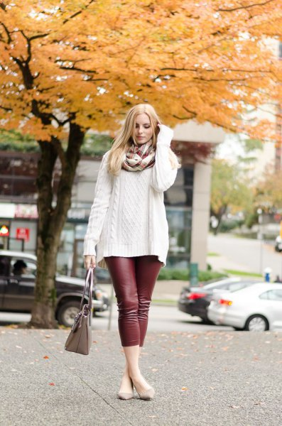white, coarsely knitted sweater with scarf and burgundy leggings