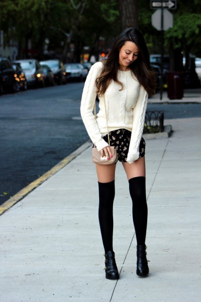 white cable knit sweater, black printed shorts
