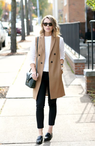 white cable knit sweater with a red, sleeveless wool coat and slippers