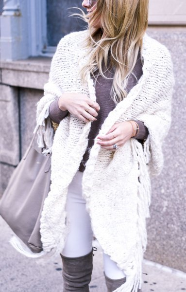 white cable knit sweater with overknee boots